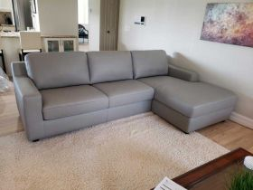 J&M Lauren Premium Leather Sectional Sofa Sleeper in Cream with Left Facing Chaise